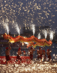 Folk artists perform a fire dragon dance amid molten iron at 1,300 degrees Celsius in Beijing