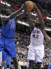76ers forward Brand battles for a rebound with the Mavericks center Mahinmi during the second half of NBA basketball game action in Philadelphia Pennsylvania