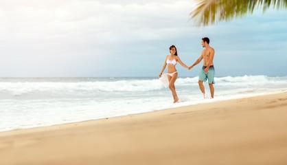 loving couple enjoying and walk on beach