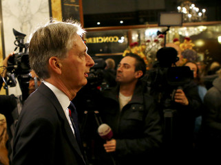 Britain's Foreign Secretary Hammond arrives in a hotel before a meeting in Vienna