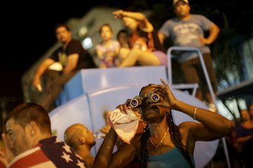 Fans attend a free outdoor concert by the Rolling Stones at the Ciudad Deportiva de la Habana sports complex in Havana