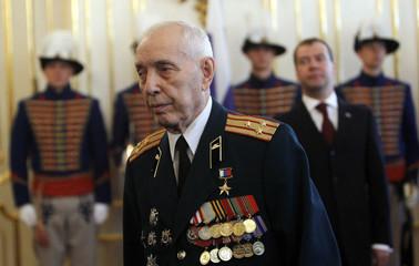 Russian President Medvedev looks at Russian World War II veteran Mikhailovich Fadin in Bratislava