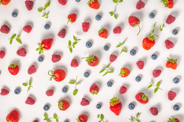 flat lay of trendy seamless pattern strawberry, raspberries, blueberry berries and mint like background, concept of healthy eating