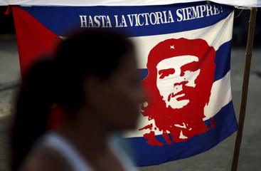 Supporter of Venezuela's President Nicolas Maduro stands next to a Cuban flag with an image of Che Guevara, during a demonstration outside the U.S. Embassy in Buenos Aires