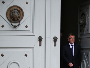 Hungary's newly minted central bank Governor Gyorgy Matolcsy leaves the presidential palace after his swearing-in ceremony in Budapest
