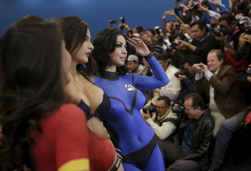 """Exotic dancers in body paint pose for the media during a news conference to promote the """"Expo Sex and Entertainment"""" adult exhibition at the Palacio de los Deportes in Mexico City"""