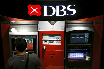 A man uses a DBS automated teller machine in Singapore