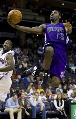 Kings' Evans shoots the ball against the Charlotte Bobcats during an NBA basketball game in Charlotte