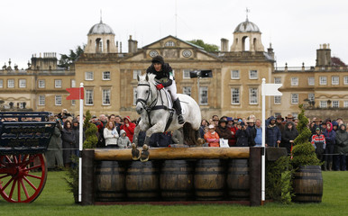 South Africa's Alexander Peternell on Tiger's Eye II navigates a jump in front of Badminton House during the cross country on the third day of The Badminton Horse Trials