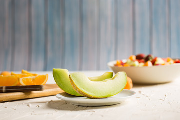 Delicious Melon Slices on table