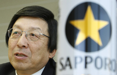 Sapporo Holdings Chief Executive Takao Murakami speaks next to a Sapporo draft beer can during an interview at the company's headquarters in Tokyo
