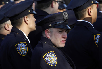 New York City Police officers from 75th Precinct in East New York listen to funeral mass for their slain fellow officer Figoski in Babylon