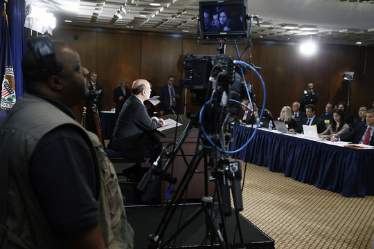 Bernanke responds to reporters during his final planned news conference before his retirement, at the Federal Reserve Bank headquarters in Washington