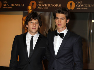 Actors Andrew Garfield and Jesse Eisenberg pose at The Governors Awards in Hollywood