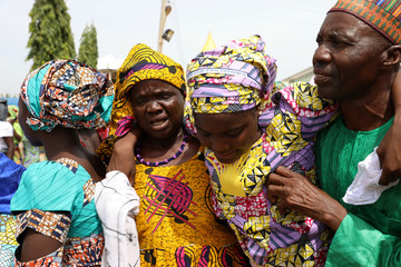 One of the Newly released 82 Chibok school girls embraces her parents as she reunites with her family in Abuja