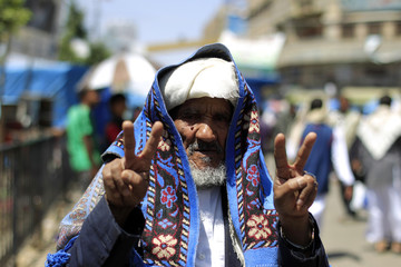 Anti-government protester flashes victory signs after demonstration to demand ouster of Yemen's President Saleh in Sanaa