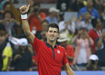 Novak Djokovic of Serbia reacts after winning against Simone Bolelli of Italy in their men's singles match at the China Open tennis tournament in Beijing