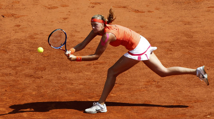 Kvitova of the Czech Republic returns the ball to Li Na of China during the French Open tennis tournament at the Roland Garros stadium in Paris