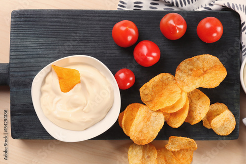 Composition With Tasty Mayonnaise Sauce On Wooden Table
