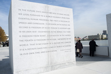 Visitors make their way through the Franklin D Roosevelt Four Freedoms Park during the park's opening ceremony in New York