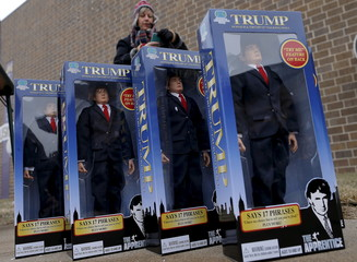 A vendor sells U.S. Republican presidential candidate Donald Trump dolls outside a campaign event in Muscatine