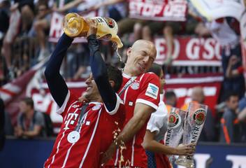 Bayern Munich's Thiago Alcantara and Arjen Robben celebrate after winning the Bundesliga