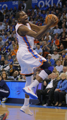 Oklahoma City Thunder's Durant spins to shoot against Toronto Raptors during their NBA basketball in Oklahoma City