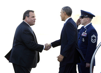 U.S. President Barack Obama shakes hands with New Jersey Governor Chris Christie after arriving at Joint Base McGuire-Dix-Lakehurst in New Jersey