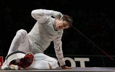 Cheremisinov of Russia celebrates victory against Lefort of France during their men's foil semi-final at the World Fencing Championships in Kazan