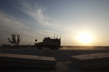 MRAP vehicle drives to refuel before while waiting at a staging area in Camp Adder to be part of the last U.S. military convoy to leave the country near Nasiriyah