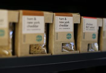 Boxed deli sandwiches are shown for sale inside a newly designed Starbucks coffee shop in Fountain Valley, California