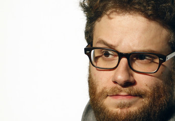 Cast member Rogen raises his eyebrow during a news conference for the film The Green Hornet in Taipei