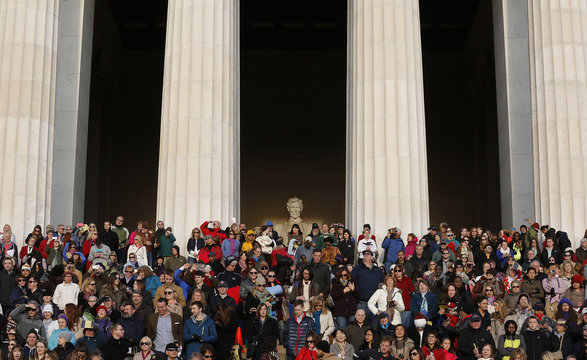 Crowds cover the steps during an Easter morning sunrise religious service at the Lincoln Memorial in Washington