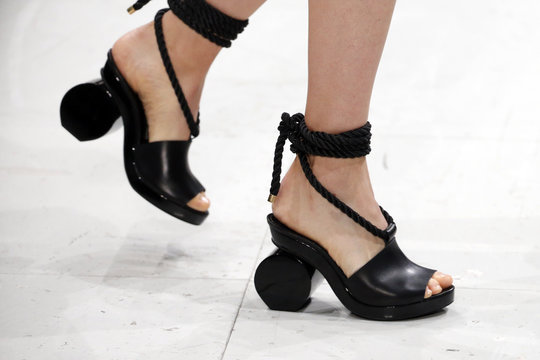 A model presents a shoes creation by designer Hussein Chalayan as part of his Spring/Summer 2016 women's ready-to-wear collection show during the Fashion Week in Paris