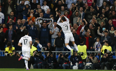 Real Madrid's Cristiano Ronaldo celebrates after scoring his second goal during their round of 16 second leg soccer match in Madrid