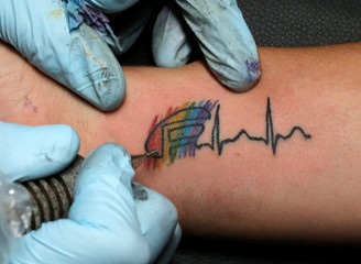 Becky Roero gets a tattoo done by Ron Rivera at Stigma Tattoo Bar to raise funds for the families of the victims who were killed at the Pulse gay nightclub in Orlando