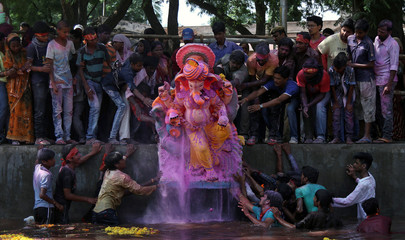 Devotees carrying an idol of the Hindu god Ganesh, the deity of prosperity, immerse the idol on the last day of the ten-day-long Ganesh Chaturthi festival in Ajmer