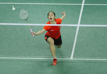 China's Wang hits a shot during her match against South Korea's Bae as part of the two countries' women's team gold medal badminton match at the Asian Games in Incheon