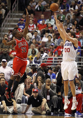 76ers' Hawes shoots a three point shot under pressure from Bulls' Butler during their NBA Eastern Conference quarter-final playoff basketball game in Philadelphia