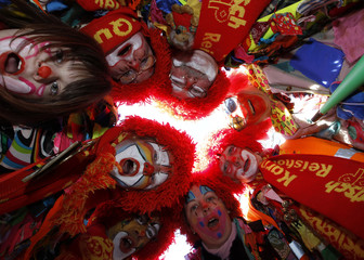Carnival revellers dressed as clowns pose during the carnival parade in Duesseldorf