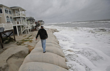 Cage Deal, a senior at Whiteville High School, gets video footage of the waves of Hurricane Sandy in Ocean Isle Beach