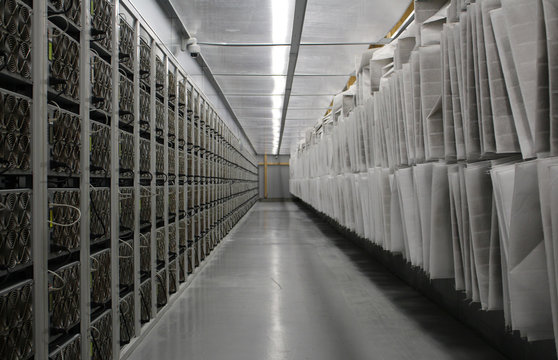 Bitcoin mining computers and particle filters that allow in cold air from outside but trap any incoming dust are pictured in Bitfury's mining farm near Keflavik