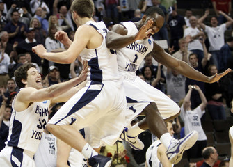 BYU players celebrate defeating Gonzaga in their third round NCAA tournament basketball game in Denver