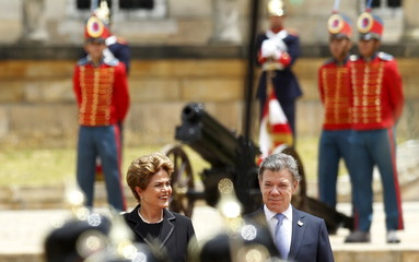 Brazil's President Dilma Rousseff reviews an honour guard before a meeting with Colombia's President Juan Manuel Santos at the Narino Palace in Bogota