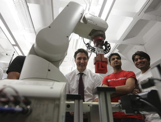 Liberal leader Trudeau uses a robotic machine during a campaign stop in Hamilton