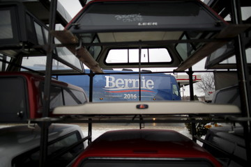 U.S. Democratic presidential candidate and U.S. Senator Bernie Sanders campaign bus drives after an event at the United Steelworkers Local in Des Moines, Iowa