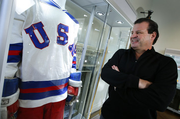 "Mike Eruzione, captain of the 1980 gold medal winning U.S. Olympic ice hockey team looks over the jersey and uniform he wore when the U.S. defeated the Soviet Union in what is known as the ""Miracle on Ice"" at Heritage Auctions in New York City"