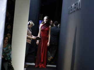 A model waits to be sent out on the runway during the Vivienne Tam Fall/Winter 2012 collection show during New York Fashion Week