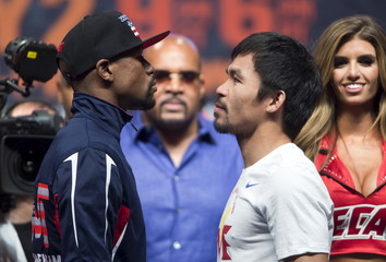 Undefeated WBC/WBA welterweight champion Mayweather of the U.S. and WBO welterweight champion Pacquiao of the Philippines face off during an official weigh-in at the MGM Grand Garden Arena in Las Vegas