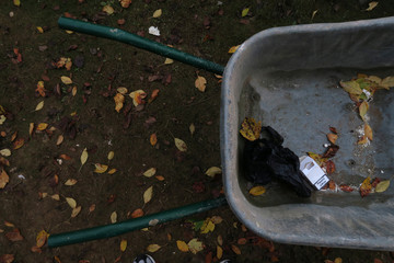 A packet of cigarettes with the Polish words Palenie Zabija (smoking kills) printed on it is left in a wheel barrow on a construction site in a residential building in London